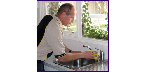 the final touches of a kitchen plumbing repair